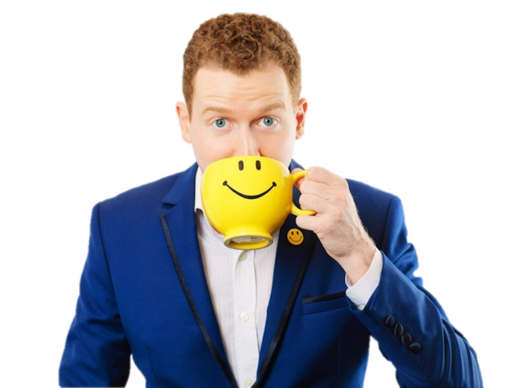 Chris Butsch the Workplace Happiness Expert with smile mug