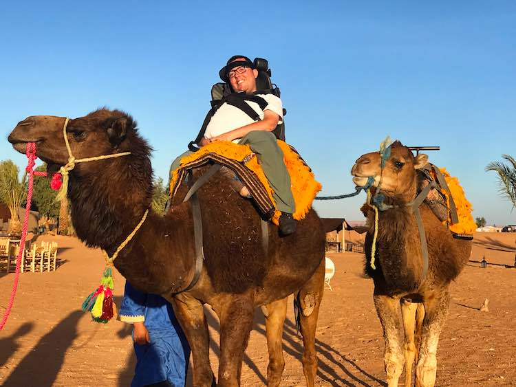Cory Lee riding a camel