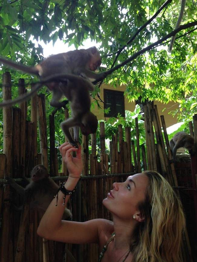 Alyssa Ramos playing with monkeys
